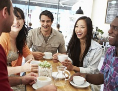 Group of young adults in a cafe setting.