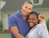 African American couple with keys to their new house.